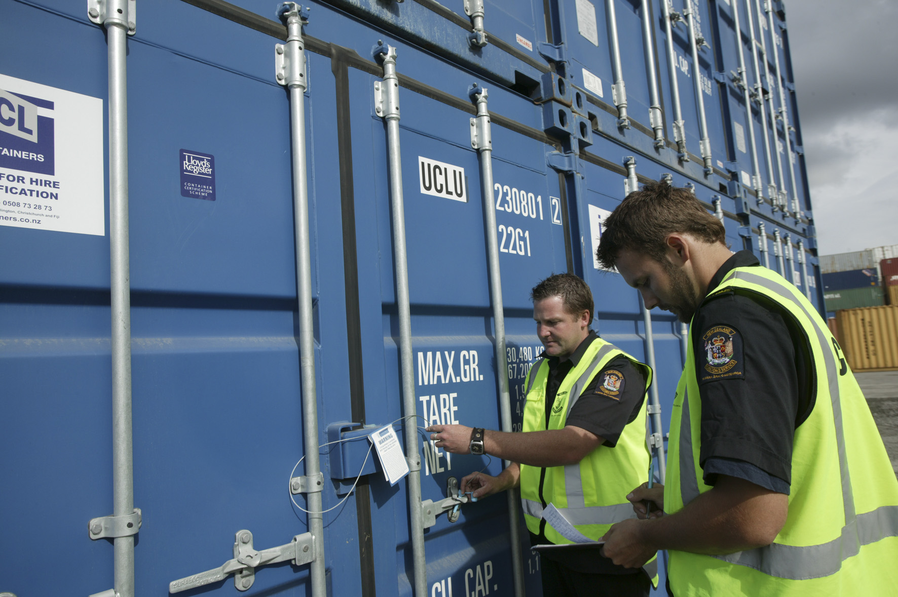 Customs officers inspecting containers
